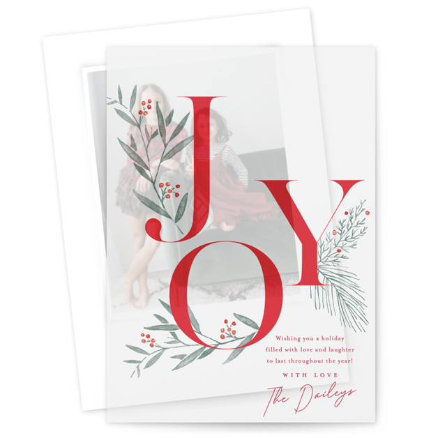 This is a red vellum holiday card by Oscar & Emma called Joy Greenery with standard printing on translucent vellum in overlay.