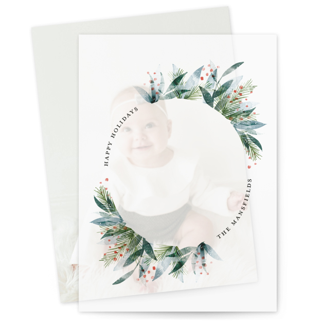 This is a green vellum holiday card by Jackie Crawford called Watercolor Painted Wreath with standard printing on translucent vellum in overlay.