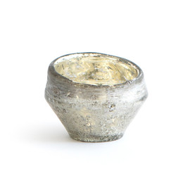 This is a silver votive holder by Minted called Small Organic Glass.