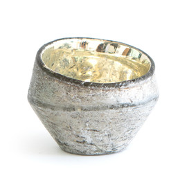 This is a silver votive holder by Minted called Large Organic Glass.