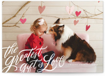 This is a white valentine postcard by Wildfield Paper Co called the greatest gift with standard printing on signature in postcard.