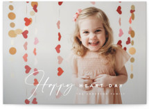 This is a red valentine postcard by Laura Hamm called Happy Heart Day with standard printing on signature in postcard.