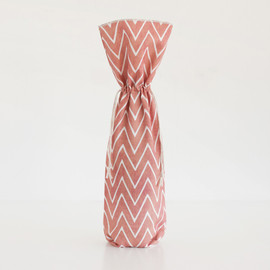 This is a red wine bag by Hooray Creative called Watercolor Chevrons.
