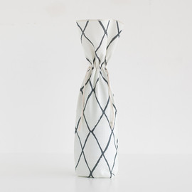 This is a black and white wine bag by Hooray Creative called Criss-Crossed.