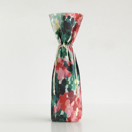 This is a colorful wine bag by Holly Whitcomb called Hollyhocks.