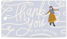 This is a blue baby shower favor tag by Meggy Masters called Winter Skate with standard printing on signature in sticker.
