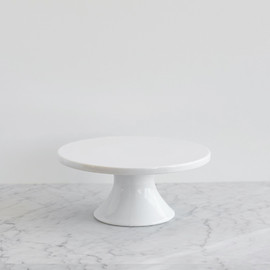 This is a white dessert table accessory by Minted called Small White Porcelain.