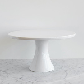 This is a white dessert table accessory by Minted called Large White Porcelain.