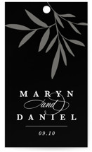 This is a black wedding favor tag by Kate Ahn called Aria with standard printing on signature in tag.