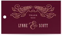 This is a red wedding favor tag by Laura Bolter Design called Opulence with standard printing on signature in tag.