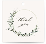 This is a beige wedding favor tag by Lori Wemple called Green Wreath with standard printing on signature in tag.