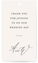 This is a beige wedding favor tag by Leah Bisch called Timeless with standard printing on signature in tag.