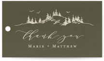This is a green wedding favor tag by Halik Helen called into the mountains with standard printing on signature in tag.