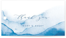 This is a blue wedding favor tag by Yuliya Evseeva called Watercolor waves with standard printing on signature in tag.