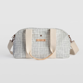 This is a grey travel duffel bag by Oma N. Ramkhelawan called Woven in standard.