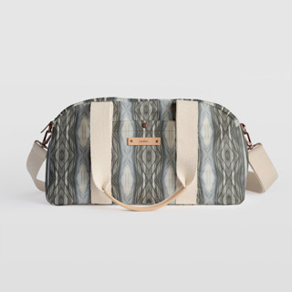 This is a brown travel duffel bag by Angela Simeone called Ikat Stripe in standard.