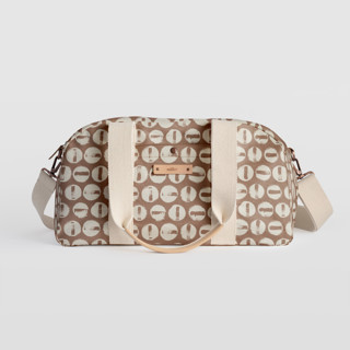 This is a brown travel duffel bag by Carrie ONeal called Penny Thoughts in standard.