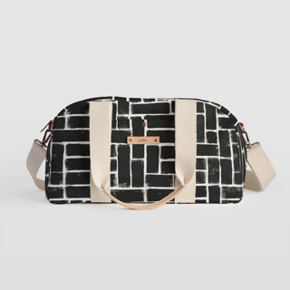 This is a black travel duffel bag by Michelle Taylor called Constructed in standard.