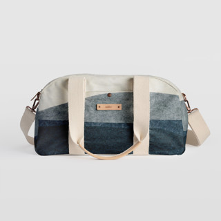 This is a blue travel duffel bag by Carrie Moradi called tissue overlay in standard.