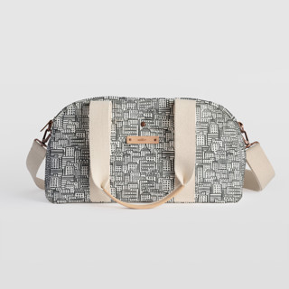 This is a black and white travel duffel bag by Snow and Ivy called City.
