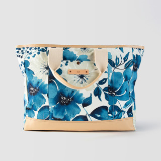 This is a blue weekender tote  by Chris Griffith called Primroses Forever.