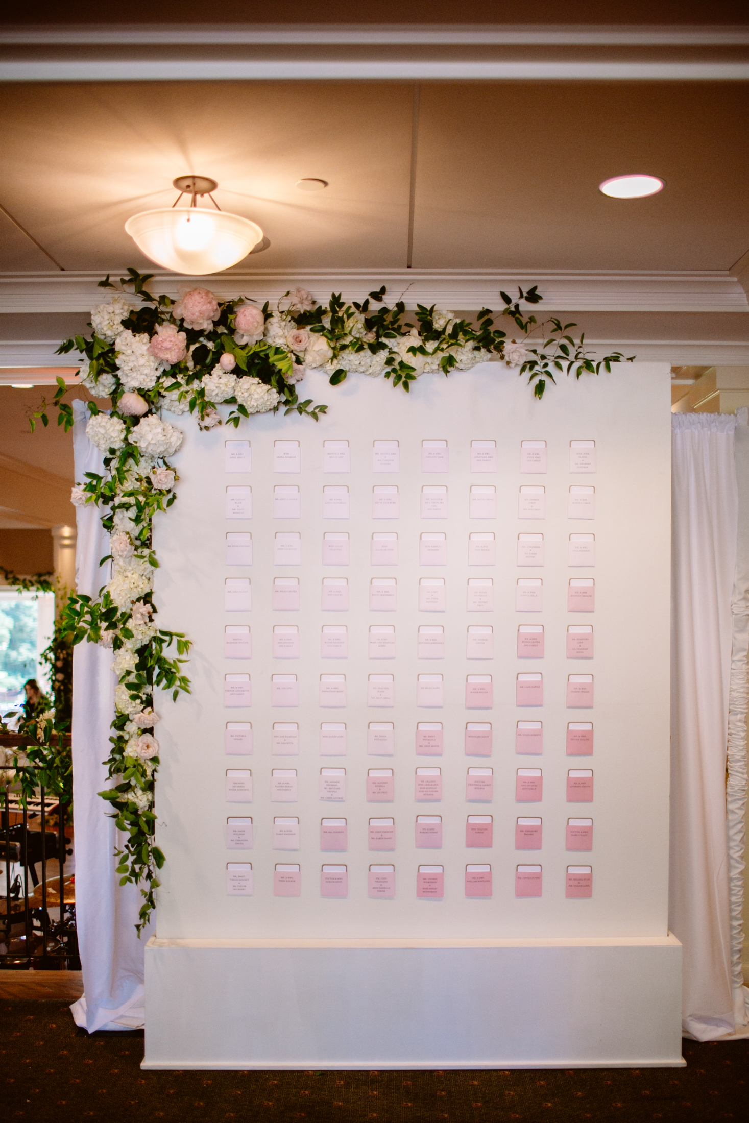 wedding day escort card display with flowers